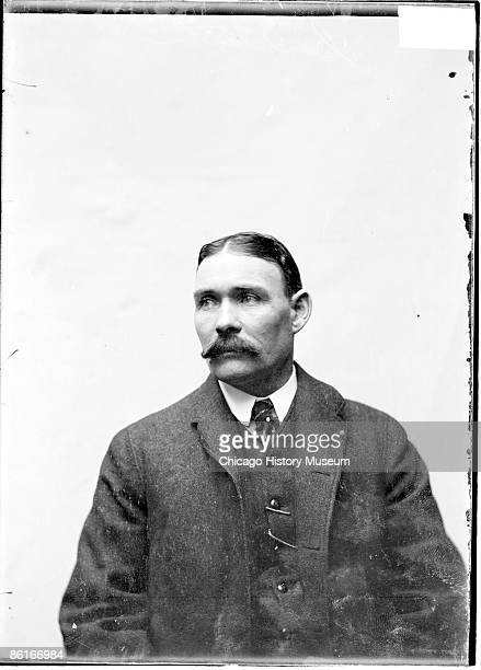 """Half-length portrait of baseball umpire Joseph """"Pongo Joe"""" Cantillon looking to his right in a three-quarter-view image, sitting against a plain..."""