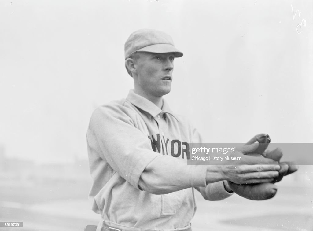 Half-length portrait of George Browne, outfielder for the New York Giants, National League baseball team, standing with his arms outstretched in front of him as if to catch a ball, at West Side Grounds, which was located between West Polk Street, South Wolcott Avenue (formerly Lincoln Street), West Taylor Street, and South Wood Street, in the Near West Side community area of Chicago, Illinois, 1903. From the Chicago Daily News collection.