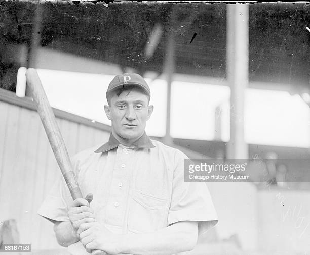 Halflength portrait of Hall of Famer Honus Wagner player for the Pittsburgh Pirates National League baseball team standing on field near grandstand...