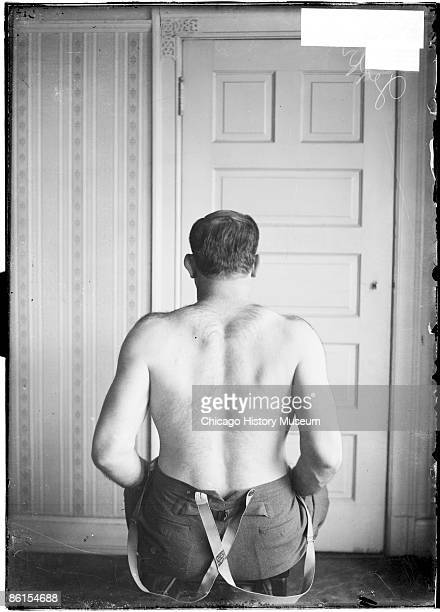 Halflength portrait of James J Jeffries pugilist with his back to the camera sitting in a chair in a room in Chicago Illinois 1905 From the Chicago...