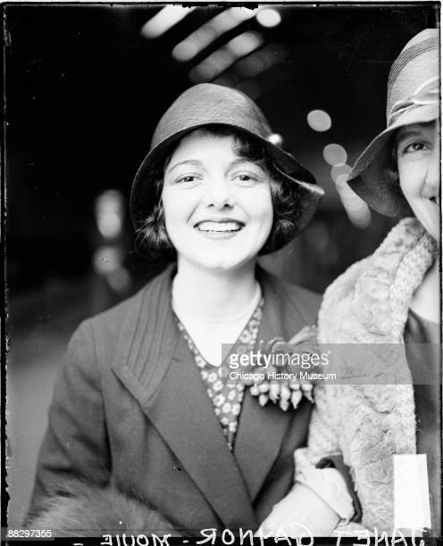 Halflength portrait of movie actress Janet Gaynor looking toward the camera and smiling standing in a railroad station in Chicago Illinois 1928 An...