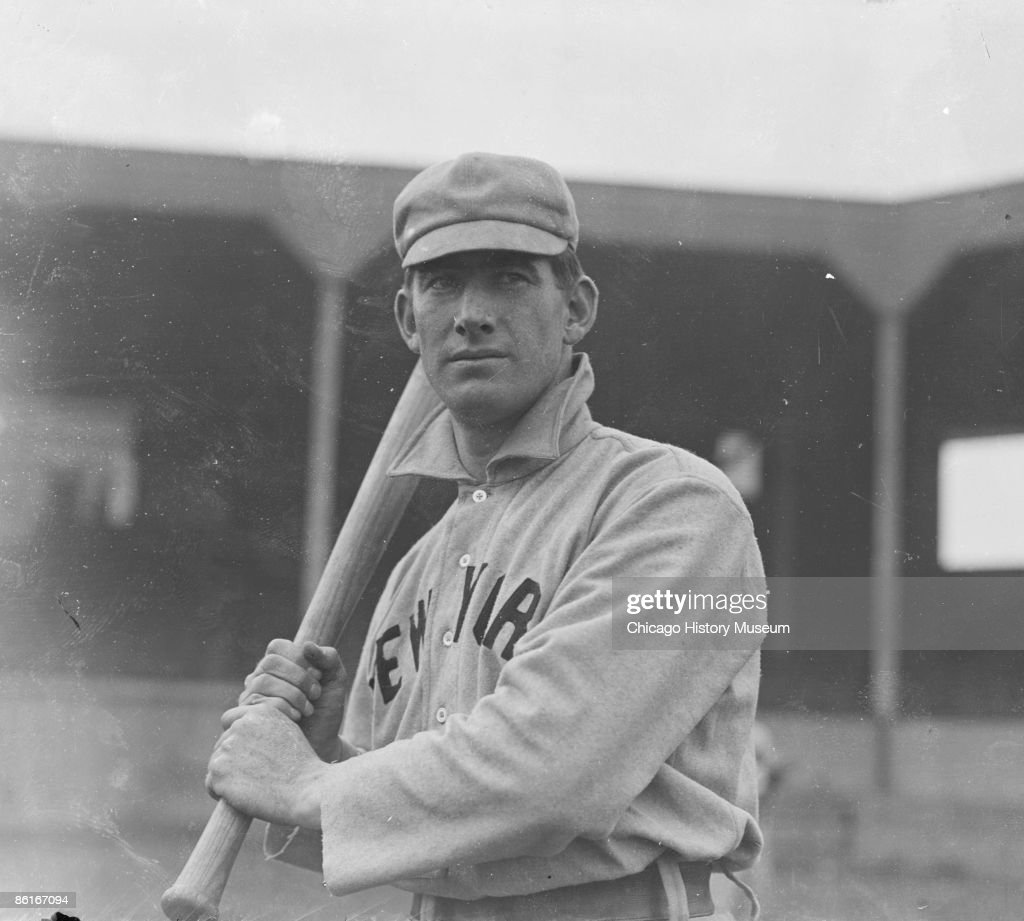 Half-length portrait of Roger Bresnahan, known as the Duke of Tralee, outfielder for the New York Giants, National League baseball team, standing with a bat over his right shoulder, in batting stance on the field at West Side Grounds, which was located between West Polk Street, South Wolcott Avenue (formerly Lincoln Street), West Taylor Street, and South Wood Street, in the Near West Side community area of Chicago, Illinois., 1903. From the Chicago Daily News collection.