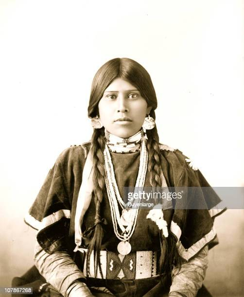Halflength portrait of young Indian woman seated facing front 1899