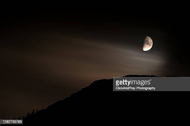half-moon on whistlefield hill - space and astronomy stock pictures, royalty-free photos & images
