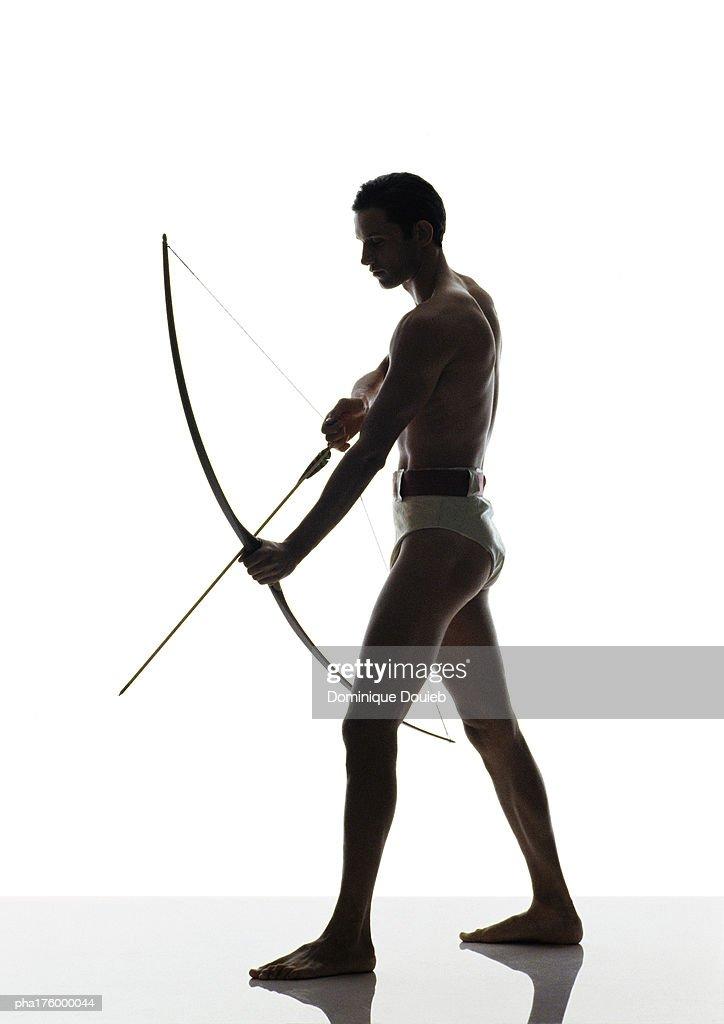 Half-nude man holding bow : Stockfoto