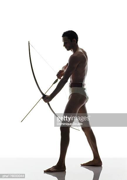 Half-nude man holding bow