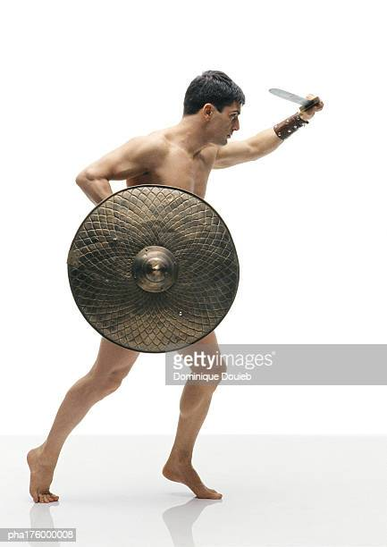 Half-nude man holding shield and sword