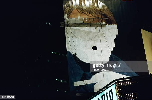 A halfpainted billboard advertising Winston cigarettes on a rooftop in Times Square New York August 1974 The billboard is novel in that actual smoke...