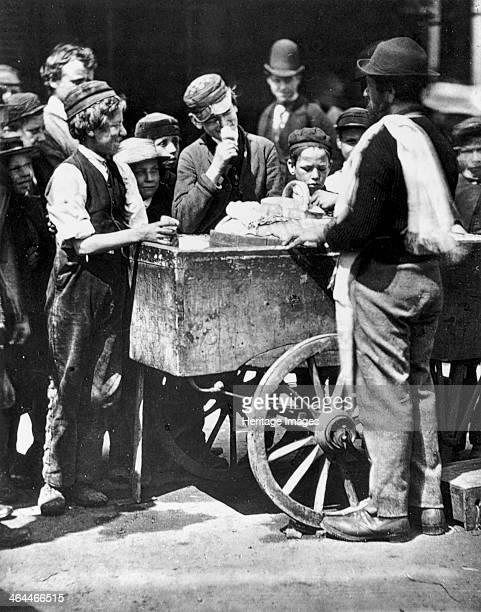 'Halfpenny Ices' 1877 Children crowd around an icecream seller and his cart From Street Life in London 1877 By John Thompson