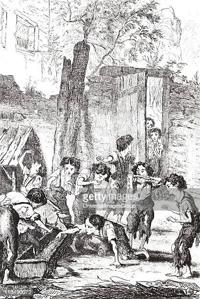 Halfstarved factory children supplementing their meagre rations by stealing food from a pig trough Many such children would have been supplied by the...