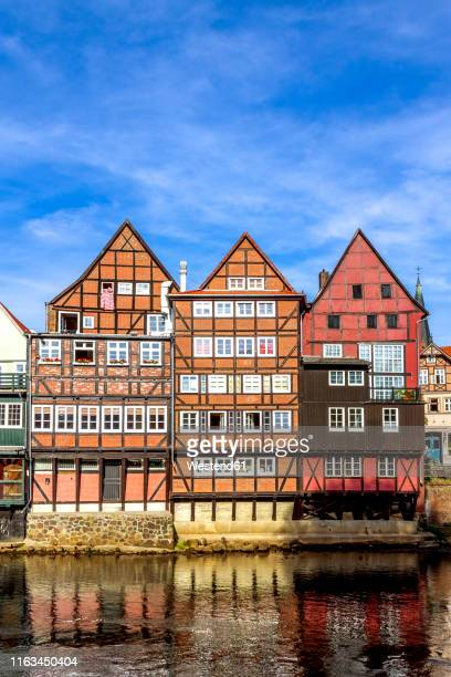 half-timbered and gable houses at ilmenau river, lueneburg, germany - lüneburg stock photos and pictures