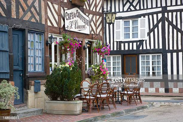 half-timbered cafe du coiffeur. - calvados stock pictures, royalty-free photos & images