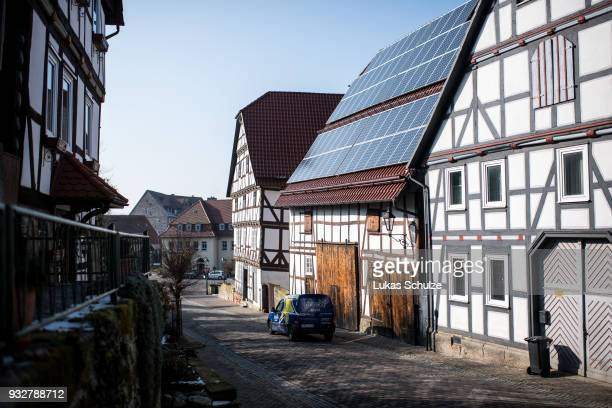 A halftimbered house with solar panels on its roof stands in the town center on February 21 2018 in Wolfshagen Germany Wolfshagen has become a model...