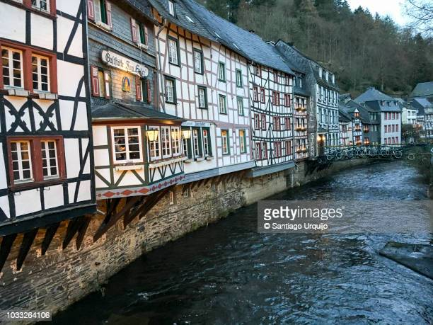 half-timbered houses alongside the rur river in monschau - north rhine westphalia stock pictures, royalty-free photos & images