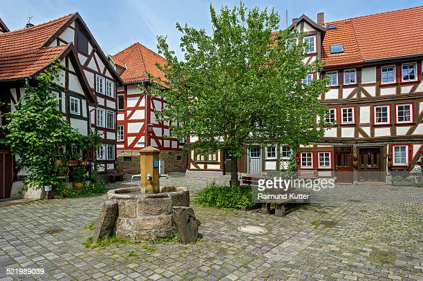 Half-timbered houses and fountain on a small square, Grabbrunnen, historic centre, Alsfeld, Hesse, Germany