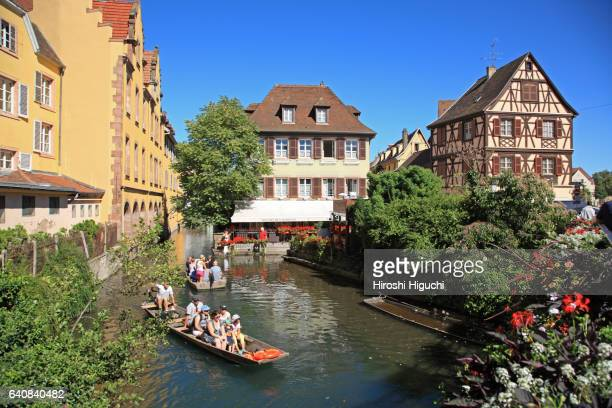 Half-timbered houses and sightseeing boat in Colmar, Alsace, France