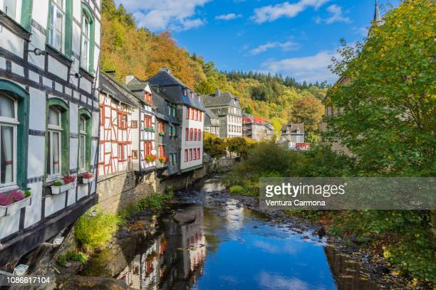 half-timbered houses on the rur river in monschau, germany - aachen stock pictures, royalty-free photos & images