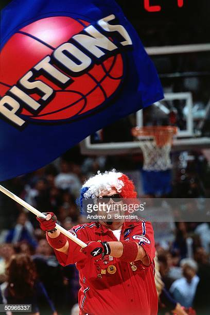 HalfTime Performers of the Detroit Pistons wave a banner and dance on court during the game against the Los Angeles Lakers during Game three of the...