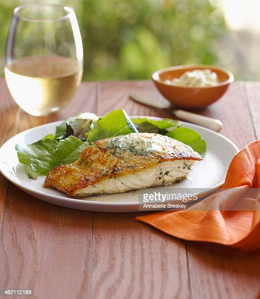 halibut served with green salad and white wine - フラットフィッシュ ストックフォトと画像
