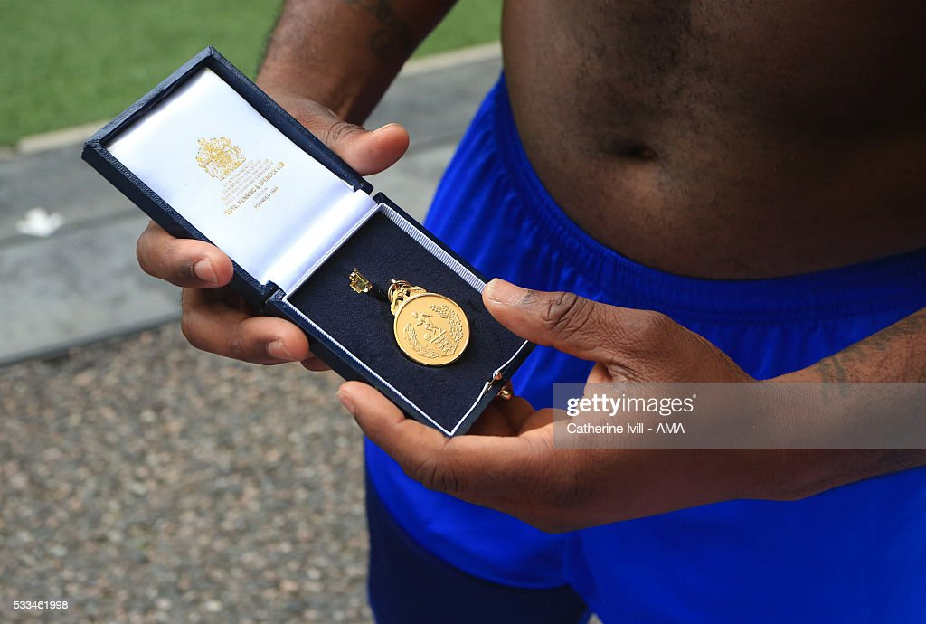 A Halifax player shows off his winners medal after The FA Trophy Final match between Grimsby Town and Halifax Town at Wembley Stadium on May 22, 2016 in London, England.