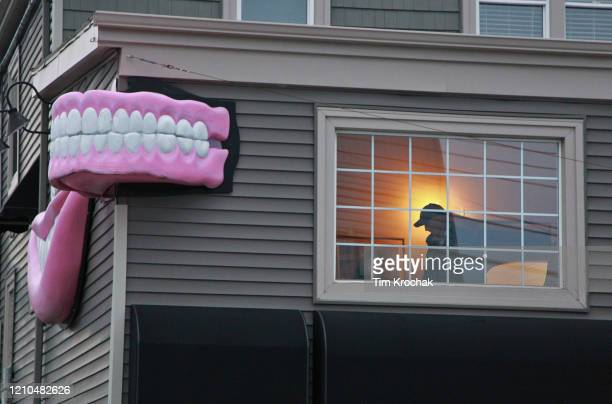Halifax regional police investigator is seen in a suite above the Atlantic Denture Clinic April 20, 2020 in Dartmouth, Nova Scotia ,Canada. The...