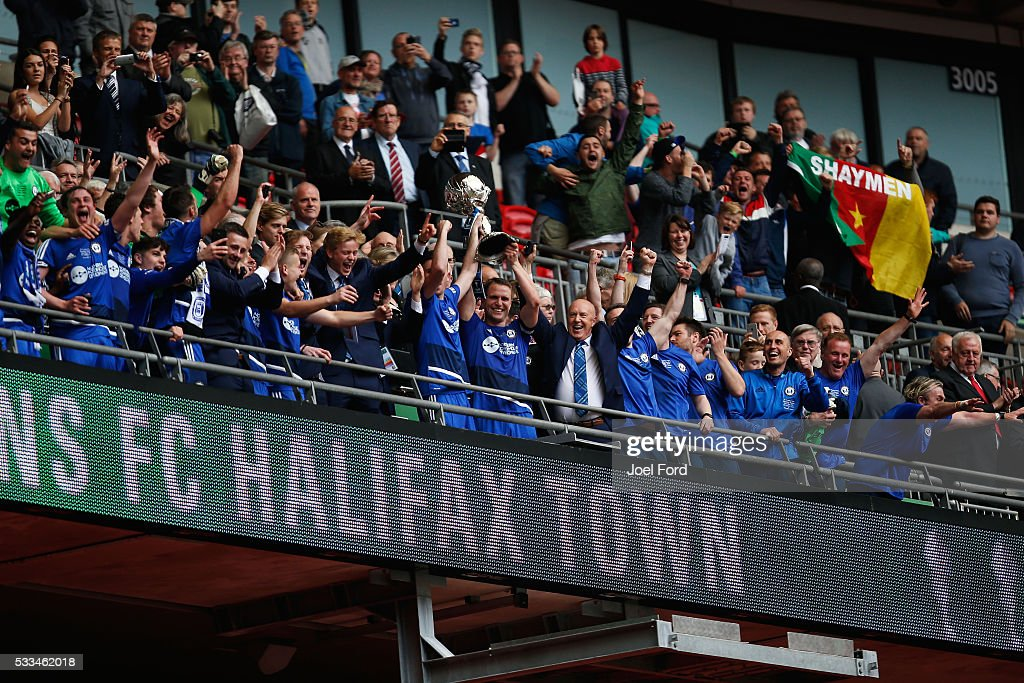Halifax Town captain Nicky Wroe lifts the FA Trophy after the FA Trophy Final match between Grimsby Town FC v FC Halifax Town at Wembley Stadium on May 22, 2016 in London, England.