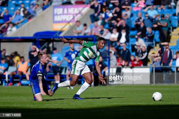 Halifax Town defender Nathan Clarke and Yeovil Town forward Gold Omotayo during the Vanarama National League match between FC Halifax Town and Yeovil...