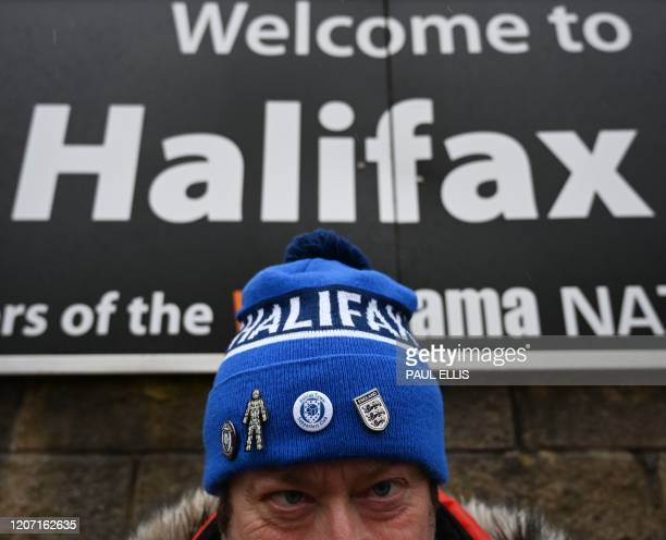 Halifax Town supporter arrives to watch the national league football match Halifax Town versus Ebbsfleet United at the Shay stadium in Halifax,...