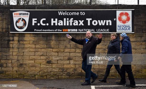 Halifax Town supporters arrive to watch the national league football match Halifax Town versus Ebbsfleet United at the Shay stadium in Halifax,...