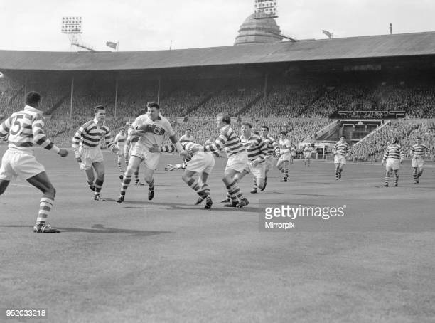 Halifax try to stem a St Helens attack during the Rugby League Cup Final at Wembley 28th April 1956