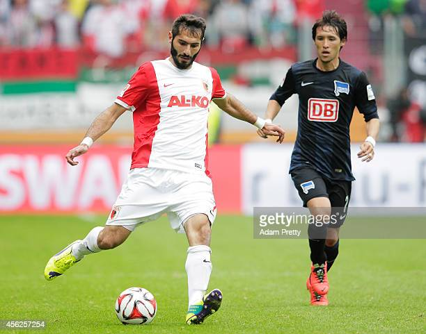 Halil Altinop of Augsburg in action during the Bundesliga match between FC Augsburg and Hertha BSC at SGL Arena on September 28 2014 in Augsburg...