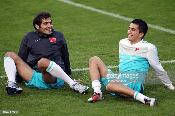 Halil Altintop and Nuri Sahin laugh during the Turkey training session at KarlLiebknecht stadium on October 4 2010 in Potsdam Germany