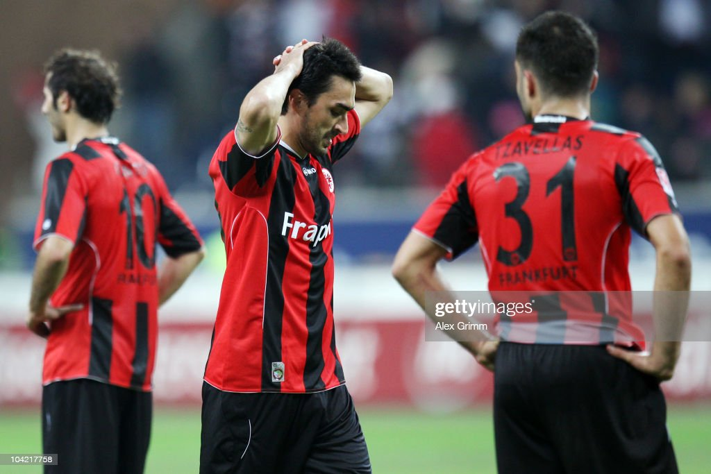 Halil Altintop, Chris and Georgios Tzavellas (L-R) of Frankfurt react after the Bundesliga match between Eintracht Frankfurt and SC Freiburg at the Commerzbank Arena on September 17, 2010 in Frankfurt am Main, Germany.