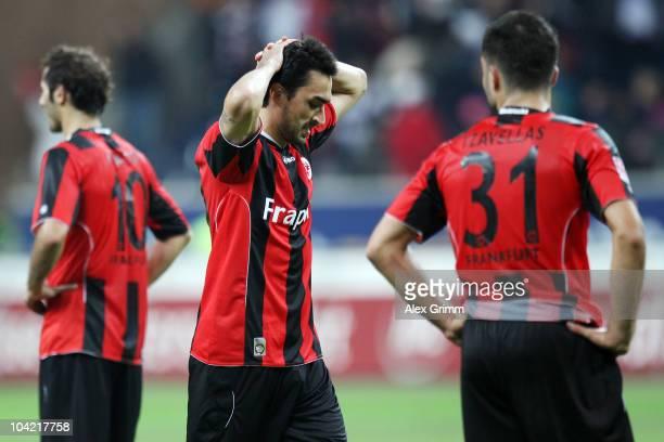 Halil Altintop, Chris and Georgios Tzavellas of Frankfurt react after the Bundesliga match between Eintracht Frankfurt and SC Freiburg at the...