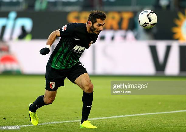 Halil Altintop heads the equalizing goal of Augsburg battle for the ball during the Bundesliga match between VfL Wolfsburg and FC Augsburg at...