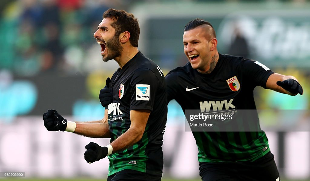 Halil Altintop (L) of Augsburg celebrates after he scores the equalizing goal during the Bundesliga match between VfL Wolfsburg and FC Augsburg at Volkswagen Arena on January 28, 2017 in Wolfsburg, Germany.