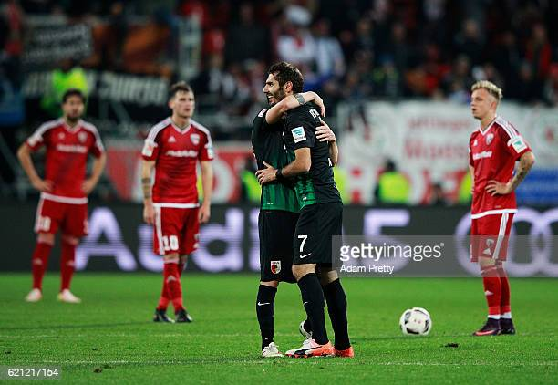 Halil Altintop of Augsburg celebrates his goal with Daniel Baier of Augsburg during the Bundesliga match between FC Ingolstadt 04 and FC Augsburg at...