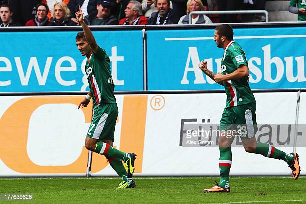 Halil Altintop of Augsburg celebrates his team's first goal with team mate Sascha Moelders during the Bundesliga match between FC Augsburg and VfB...
