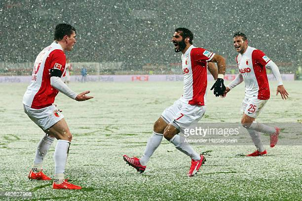 Halil Altintop of Augsburg celebrates his team's first goal with team mates PierreEmile Hojbjerg and Raul Bobadilla during the Bundesliga match...