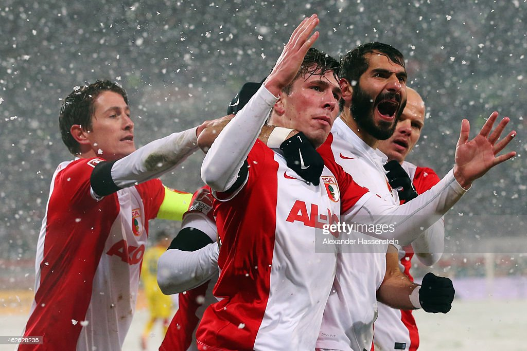 Halil Altintop (2R) of Augsburg celebrates his team's first goal with team mates Pierre-Emile Hojbjerg (2L), Tobias Werner (R) and Paul Verhaegh (L) during the Bundesliga match between FC Augsburg and 1899 Hoffenheim at SGL Arena on February 1, 2015 in Augsburg, Germany.