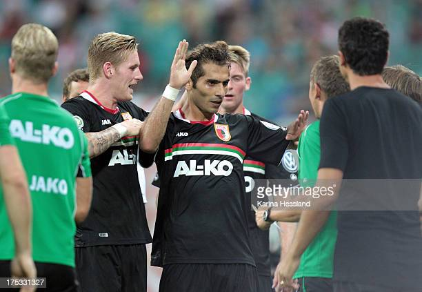 Halil Altintop of Augsburg celebrates the second goal with his team mates during the DFBCup between RB Leipzig and FC Augsburg at Zentralstadion on...
