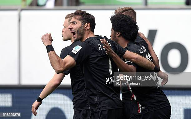 Halil Altintop of Augsburg celebrates with team mates during the Bundesliga match between VfL Wolfsburg and FC Augsburg at Volkswagen Arena on April...