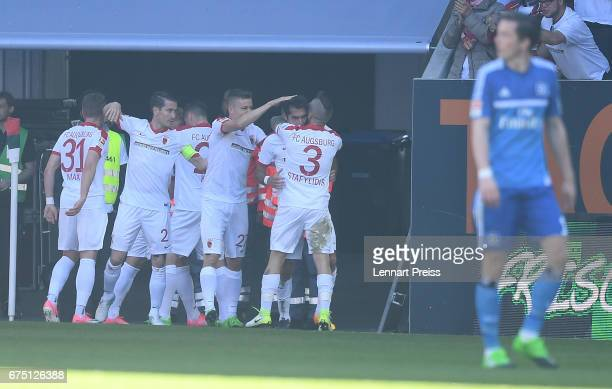 Halil Altintop of FC Augsburg and his teammates celebrate their opening goal during the Bundesliga match between FC Augsburg and Hamburger SV at WWK...
