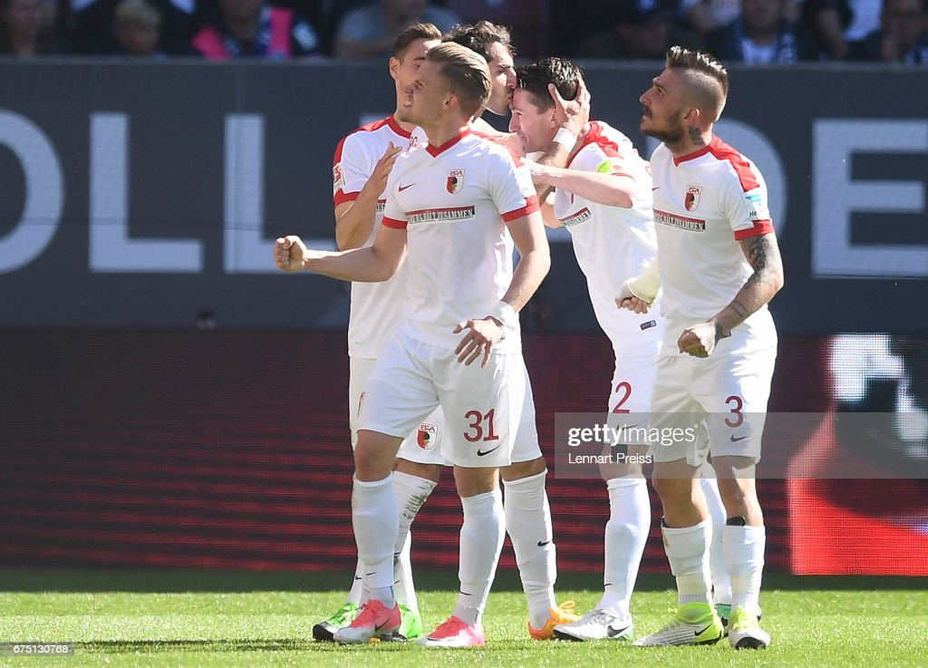 Halil Altintop (C) of FC Augsburg and his teammates celebrate their side's second goal during the Bundesliga match between FC Augsburg and Hamburger SV at WWK Arena on April 30, 2017 in Augsburg, Germany.