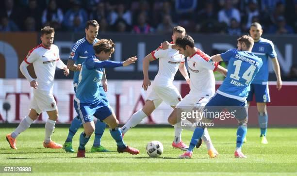 Halil Altintop of FC Augsburg challenges Aaron Hunt and Gotoku Sakai of Hamburger SV during the Bundesliga match between FC Augsburg and Hamburger SV...