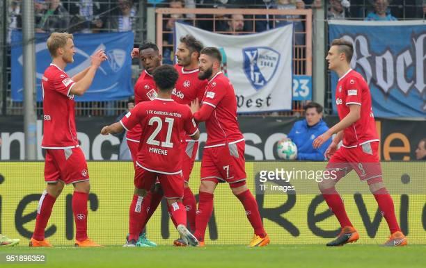 Halil Altintop of Kaiserslautern celebrates after scoring his team`s first goal with Gino Fechner, Phillipp Mwene and Brandon Borrello of...