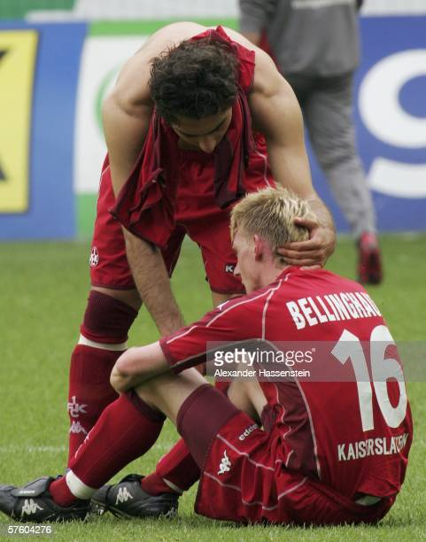 Halil Altintop of Kaiserslautern comforts his team mate Axel Bellinghausen after being relegated with his team after the Bundesliga match between VFL...