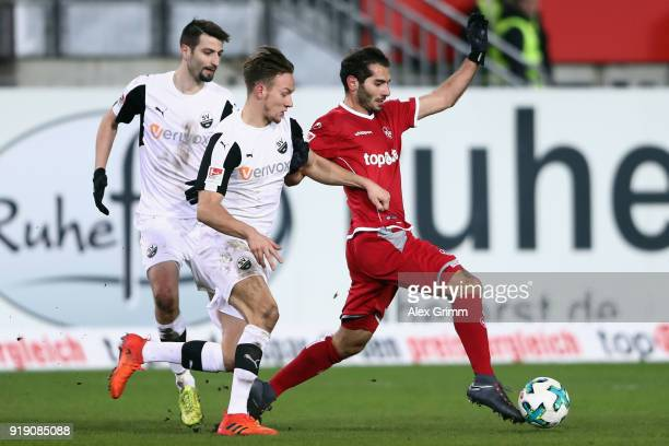 Halil Altintop of Kaiserslautern is challenged by Tim Knipping of Sandhausen during the Second Bundesliga match between 1 FC Kaiserslautern and SV...