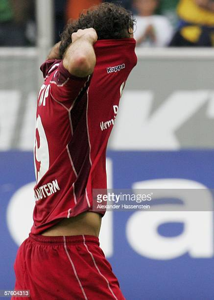Halil Altintop of Kaiserslautern looks dejected after being relegated with his team after the Bundesliga match between VFL Wolfsburg and 1FC...
