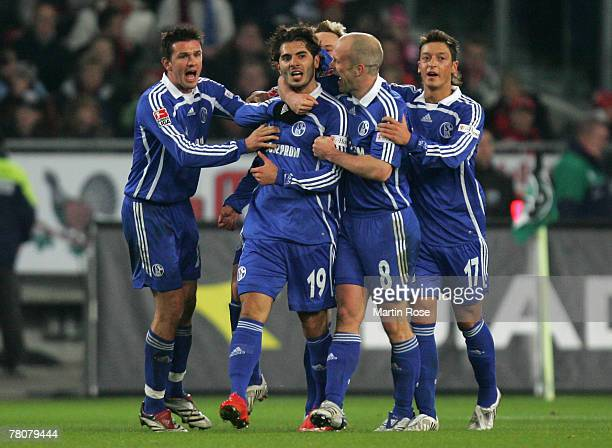 Halil Altintop of Schalke celebrates with his team mates after he scores the 3rd goal for his team during the Bundesliga match between Hanover 96 and...